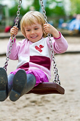 Little girl on swing - p300m981782f by Jana Fernow