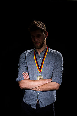 Man with prize medal - p341m2054110 by Mikesch