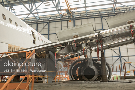 Aircraft at airlines maintenance facility - p1315m1514441 by Wavebreak