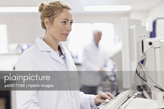 Scientist working in pathology lab - p42917108f by Hybrid Images
