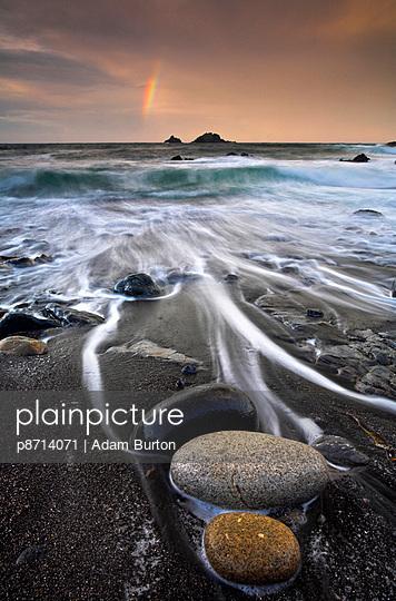 Pebbles on the beach at sunrise - p8714071 by Adam Burton