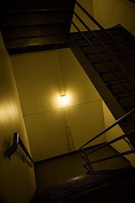 Dark hotel stairwell - p1047m953672 by Sally Mundy