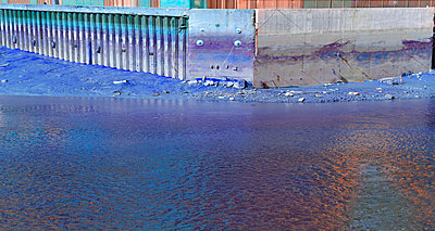 Quayside at low tide - purple - p1048m1497691 by Mark Wagner