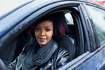 Smiling woman in car - p312m1556969 by Susanne Kronholm