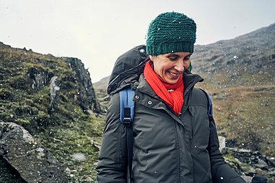 Hiker on mountain, Coniston, Cumbria, United Kingdom - p429m1494596 by Matt Lincoln