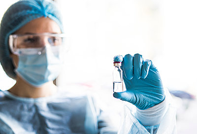 Medical doctor or laborant holding tube with nCoV Coronavirus vaccine for 2019-nCoV virus. - p1166m2235967 by Cavan Images