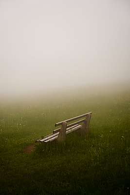 Park bench in a meadow in the fog - p1312m2285130 by Axel Killian