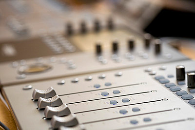 Sound mixer in a recording studio - p4902927 by Luc