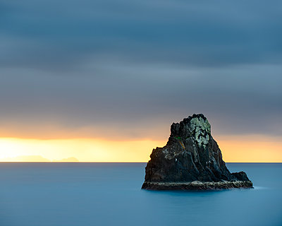 Rock in sea at sunset - p312m1493585 by Mikael Svensson