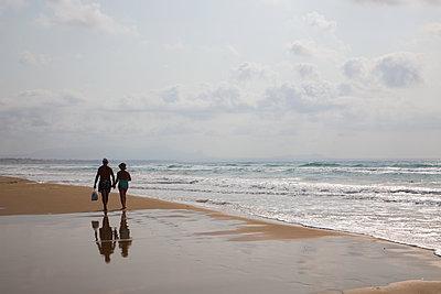 Couple on the beach - p1623m2272422 by Donatella Loi