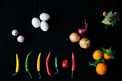 Fruits and vegetables on black background - p312m2092228 by Peter Rutherhagen
