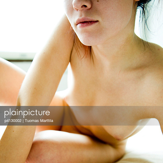 Young woman on bed - p4130002 by Tuomas Marttila