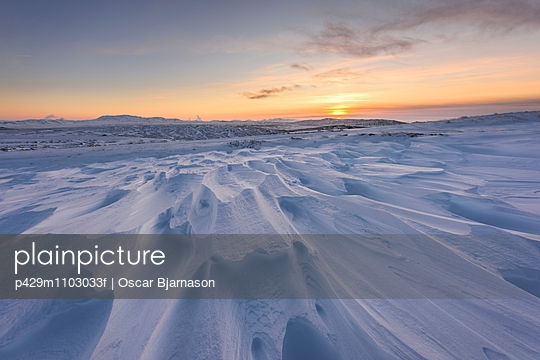 Windswept snow covered field at sunset, Skalafell, Iceland
