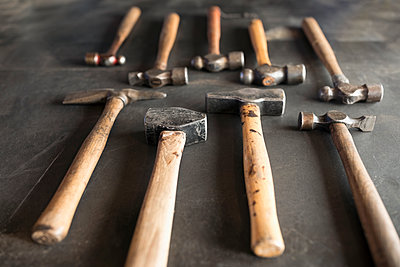 Close up still life blacksmith hammers - p1192m1529845 by Hero Images