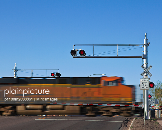 Fast Moving Train at a Railroad Crossing - p1100m2090861 by Mint Images