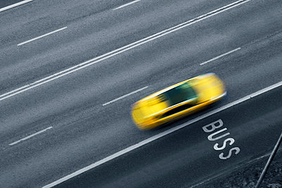 Yellow car on road - p312m993174f by Emil Fagander