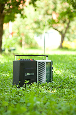 Portable radio in a park - p4541406 by Lubitz + Dorner