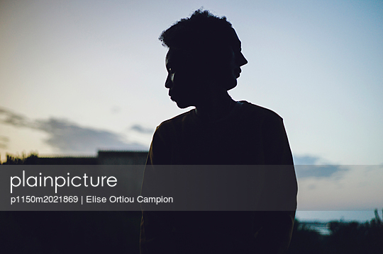 Woman in twilight - p1150m2021869 by Elise Ortiou Campion
