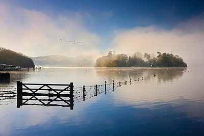 Misty morning on the shores of Derwent Water in autumn, Lake District National Park, Cumbria, England, United Kingdom, Europe - p8713036 by Adam Burton