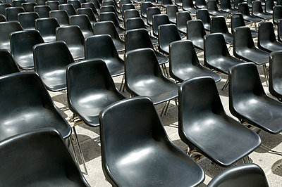Rows of black chairs - p3882111 by L.B.Jeffries