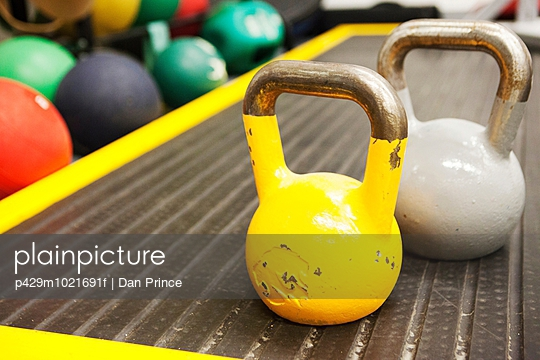 Kettle bell weights, close-up - p429m1021691f by Dan Prince