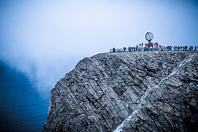 People at North Cape Globe Monument  - p1062m953965 by Viviana Falcomer