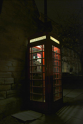Traditional red telephone box at night - p1072m829095 by John Stephenson