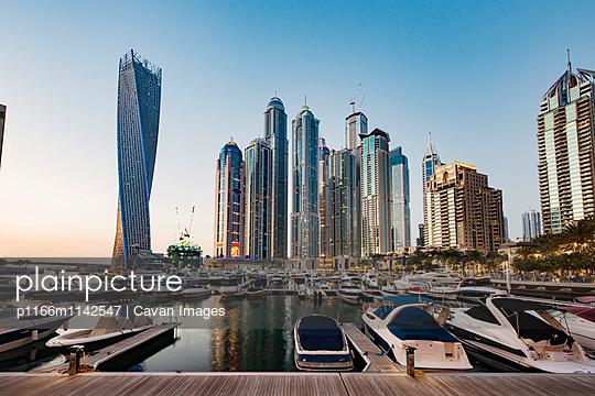 Modern buildings and harbor against clear sky - p1166m1142547 by Cavan Images