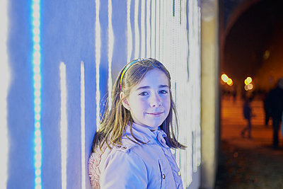 Positive young girl in casual clothes looking at camera while standin - p1166m2171493 by Cavan Images