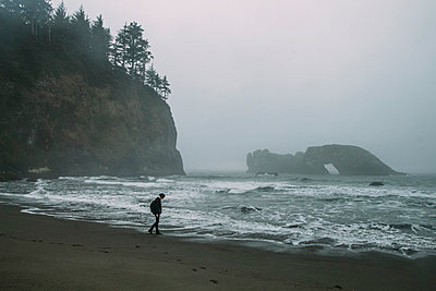 Walking on Foggy Beach - p1262m1072847 by Maryanne Gobble