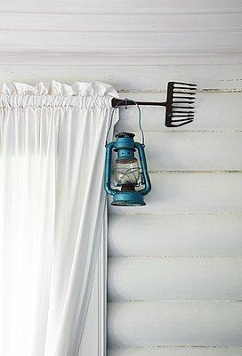 Paraffin lamp hanging on curtain rod - p1235m2287948 by Karoliina Norontaus