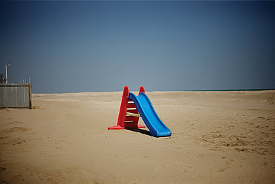 Slide on beach - p1462m1538290 by Massimo Giovannini