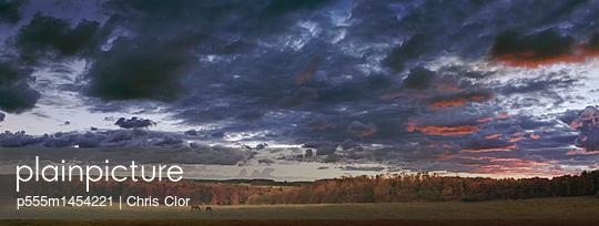 Dramatic sky over rural landscape