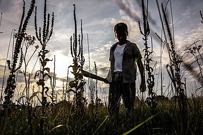 Boy in Field - p1019m1475133 by Stephen Carroll