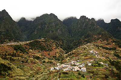 Mountain village on a slope, clouds over mountain range, La Gomera - p1643m2229416 by janice mersiovsky