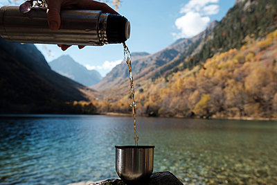 Hot tea on the background of a mountain lake - p1363m2054123 by Valery Skurydin