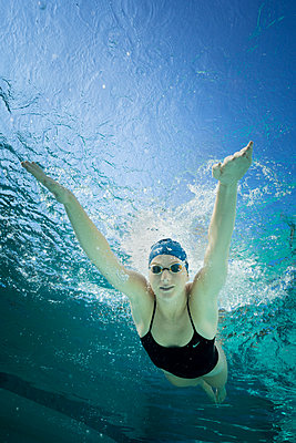 Female Swimmer with swimming goggles - p1554m2272612 by Tina Gutierrez