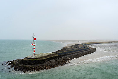 Big pier protecting the harbour from the strong current, West-Terschelling, Friesland, Netherlands, Europe - p429m1513652 by Mischa Keijser