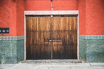 Ornate Wooden Doorway and Painted Walls, San Miguel de Allende, Guanajuato, Mexico - p694m1403877 by Eric Schwortz