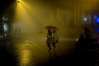 Misty street scene in the center of Sapa on a rainy night, Lao Cai Province, Vietnam, Southeast Asia - p934m1071277 by Linh Pham photography