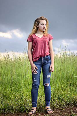 Teenager waiting by Road - p1019m1441880 by Stephen Carroll