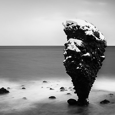 Long exposure shot of Daikoku-iwa sea rock, Yoichi, Hokkaido, Japan - p1166m2108032 by Cavan Images