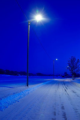 Streetlight On Snow Covered Road - p816m913342 by Arne Langleite