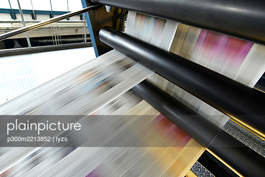 Printing of newspapers in a printing shop - p300m2213852 by lyzs