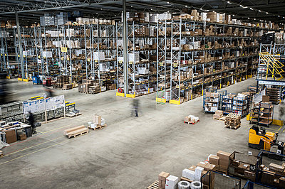Vast distribution warehouse interior, elevated view - p429m803065f by Arno Masse