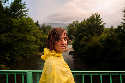 Portrait of a young woman in yellow raincoat - p1363m2063255 by Valery Skurydin