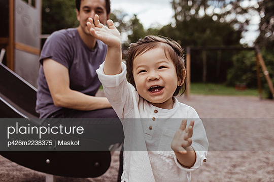 Cheerful baby son with father at park - p426m2238375 by Maskot