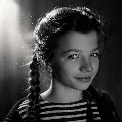 Caucasian teenage girl wearing braids - p555m1312229 by Vladimir Serov