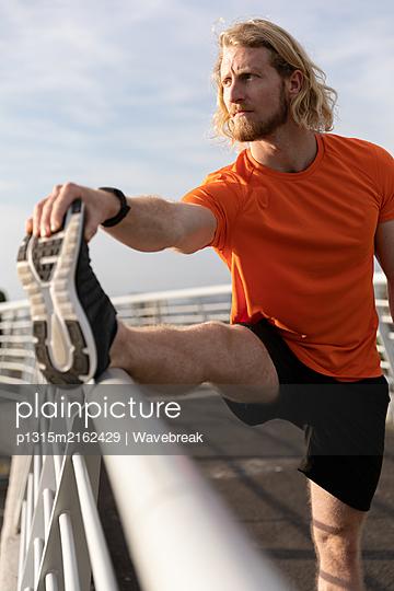 Man exercising on a footbridge - p1315m2162429 by Wavebreak