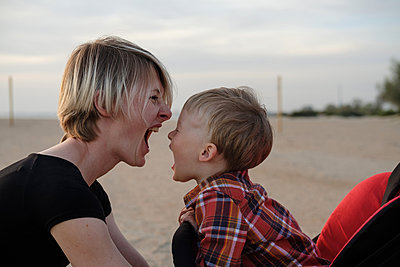 Mother and son play and scream at each other - p1363m2108770 by Valery Skurydin